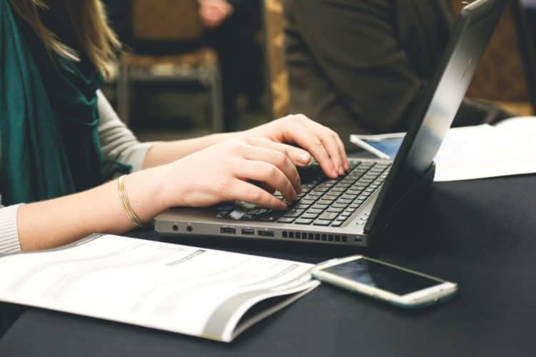 Woman writing at a laptop
